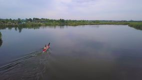 Kayak sailing on the river stock footage