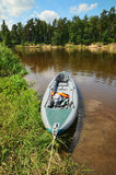 Kayak on the shore of river Royalty Free Stock Image