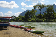 Kayak on the shore of river. Kayak on the shore of Song river,Vang Vieng, Laos Royalty Free Stock Photography