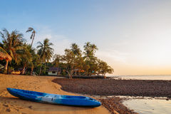 Kayak on the shore of a tropical beach on the island Royalty Free Stock Images