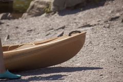 A kayak on the shores of Lake Padan, North Wales UK. A brown kayak, sitting on the lake shore on a summers afternoon stock photos