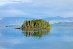 A kayak on a small lake in the yukon territories Stock Photo