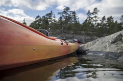 Kayak stands moored on the seashore, in the background of a clif Royalty Free Stock Image