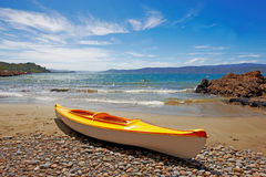 Kayak on the summer beach Royalty Free Stock Image