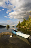 Kayak on Sunlite Shoreline Stock Photography