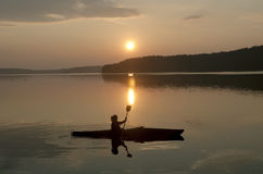 Kayak in the sunset Stock Photography