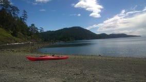 Kayak sur la plage Photographie stock