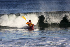Kayak surfer in action Royalty Free Stock Photography
