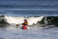 Kayak surfer in action stock photo