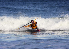 Kayak surfer in action stock photography