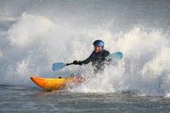 Kayak Surfing. Kayaker surfing in rough seas Royalty Free Stock Photography