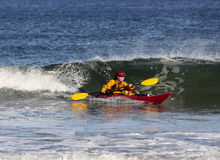 Kayak surfing on sea Royalty Free Stock Photos