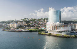 Kayak team at Fort-de-France Martinique. Fort-de-France Martinique city view with offices and homes.  Kayak team in harbor waters Royalty Free Stock Photo