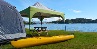 Kayak and tent in Sandspit beach New Zealand Royalty Free Stock Photo