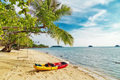 Kayak at the tropical beach Royalty Free Stock Photos