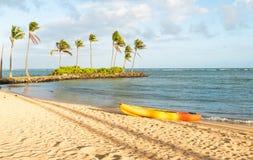 Kayak on tropical beach. Beach on tropical resort with kayak laying on the sand Stock Photo