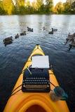 Kayak with a typewriter Stock Images