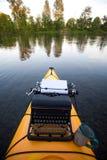 Kayak with a typewriter Royalty Free Stock Image