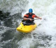 Kayak on White Water. Man riding whitewater rapids in his Kayak Royalty Free Stock Photography
