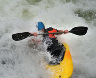 Kayak on White Water. Man riding whitewater rapids in his Kayak Royalty Free Stock Image