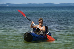 Kayak Woman and Dog Stock Photo