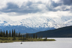 Kayak in Wonder Lake. With Mt. McKinley in the background, Denali National Park Alaska, USA Royalty Free Stock Photo