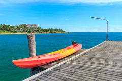 Kayak on Wooden Pier with Blue sea and sky Royalty Free Stock Photography