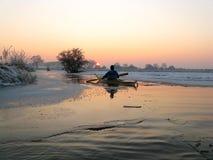 Kayaker в льде стоковая фотография