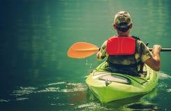 Kayaker на спокойной воде Стоковые Фото