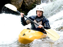 Kayaker. A shot of the kayaker with an oar on the water Royalty Free Stock Photo