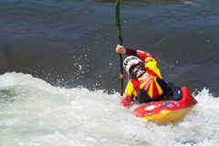 Kayaker. A kayaker negotiates a whitewater section at the Reno River Festival. This yearly event draws competitors from around the world to compete at the Royalty Free Stock Photos