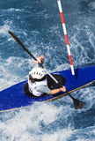 Kayaker. Manoeuvring in a fast whitewater river royalty free stock photography