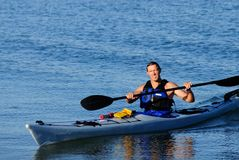 Kayaker arrives squinting in the bright sunlight Stock Images