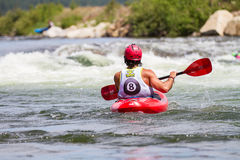 Kayaker in a 8 ball race Royalty Free Stock Image