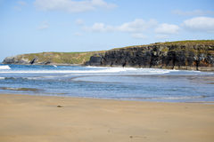 Kayaker at ballybunion. Bright winter view of kayaker at ballybunion beach and cliffs on the wild atlantic way in ireland Stock Photo
