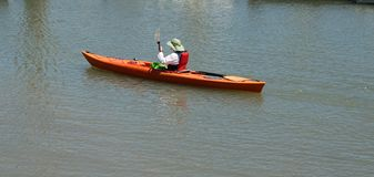 Kayaker in a boat Royalty Free Stock Image