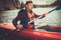 Kayaker on a boat Royalty Free Stock Images