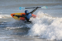 Kayaker Capsizing. Kayaker with arms and oar outstretched in an attempt to avoid capsizing Royalty Free Stock Images