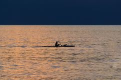 Kayaker de la puesta del sol de Hawaiin Foto de archivo libre de regalías