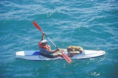 Kayaker and Dog in Water Stock Photo