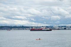 Kayaker on Elliot Bay, Seattle, WA stock images