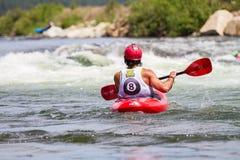 Kayaker en una raza de bola 8 Imagen de archivo libre de regalías