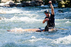 Kayaker in a fast flowing river Royalty Free Stock Image