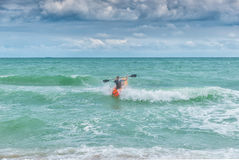 Kayaker fighting waves on furious sea Royalty Free Stock Photos