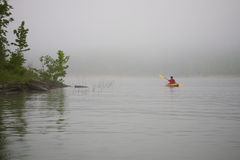 Kayaker On Foggy Lake Stock Photography