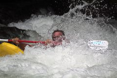 Kayaker Getting lost in the Rapids royalty free stock photography