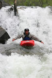 Kayaker hand paddling waterfall Royalty Free Stock Photo