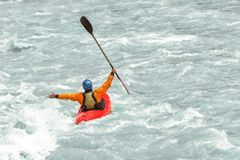 Kayaker having fun in white water rapids, with copy space Royalty Free Stock Images