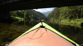 Kayaker in the Kayak on the Scenic Lake stock footage