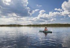 Kayaker on a lake Royalty Free Stock Image